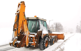 backhoe in snow